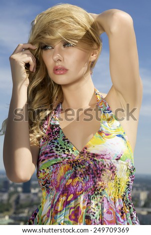 Portrait of pretty young adult attractive and sensuality sexy beautiful blonde babe girl woman on background blue summertime sunny sky.  - stock photo