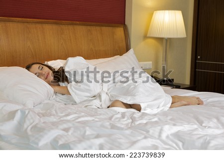 Portrait of pretty young adult attractive sexy and sensuality beautiful brunette woman sleeping in bed on luxury style apartment