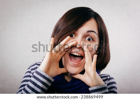 portrait of pretty young beautiful woman loud screaming or calling out to someone - stock photo