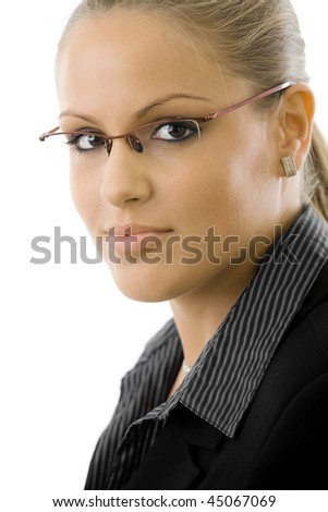 Portrait of pretty young businesswoman wearing glasses, isolated on white badkground. - stock photo