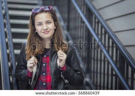 Portrait of Pretty Young Female Student With Backpack on Staircase. - stock photo