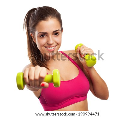 portrait of pretty young girl exercising with weight - stock photo