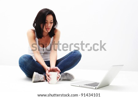 Portrait of pretty young girl looking at laptop - stock photo