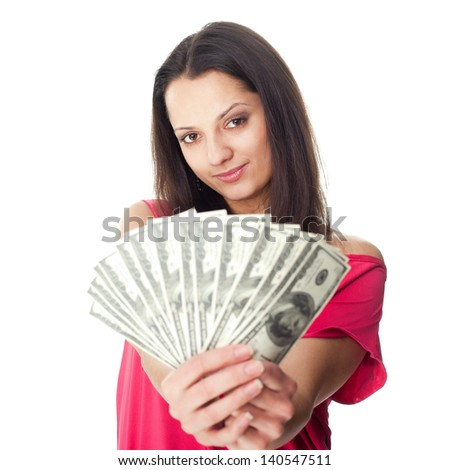 Portrait of pretty young smiling woman holding a dollar bills isolated on white background - stock photo