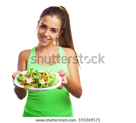 portrait of pretty young sporty woman  holding a salad