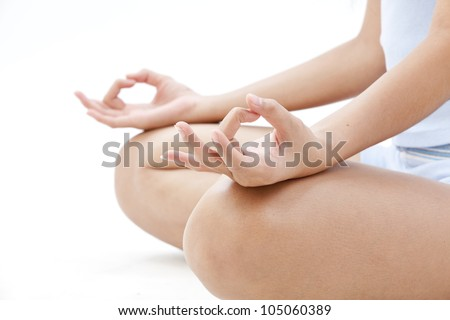 Portrait of pretty young woman doing yoga exercise - stock photo