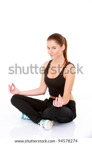 Portrait of pretty young woman doing yoga on white
