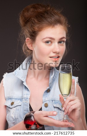 Portrait of pretty young woman drinking white wine