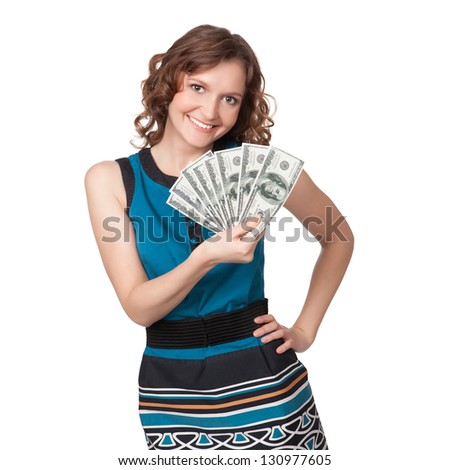 Portrait of pretty young woman holding a fan of dollar bills on white background - stock photo