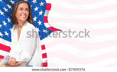 Portrait of pretty young woman holding book in her arms. USA Flag on background. International education concept. Copyspace - stock photo
