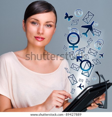 Portrait of pretty young woman holding Touch Screen tablet computer and using it to manage all her deals and needs. Multifunctional modern device. Manage your life online concept. - stock photo
