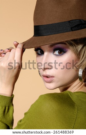 Portrait of pretty young woman in cap  - stock photo