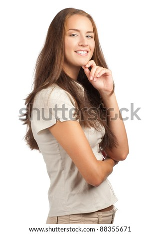 Portrait of pretty young woman in casual wear with crossed arms, against white background - stock photo