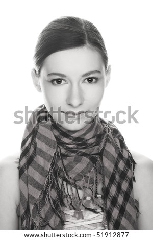 Portrait of  pretty young woman in pink and black scarf