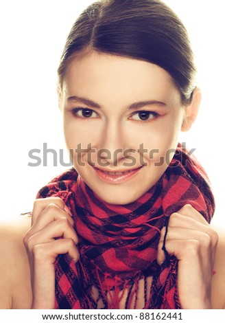 Portrait of  pretty young woman in pink and black scarf - stock photo