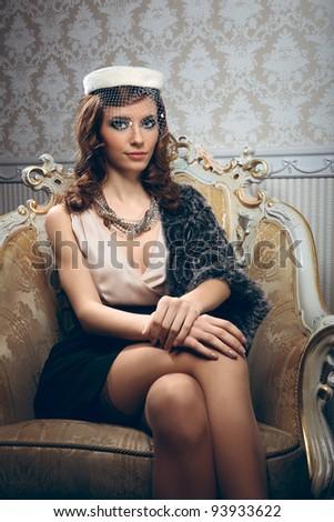Portrait of pretty young woman in retro style - stock photo