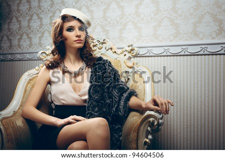 Portrait of pretty young woman in retro style - stock photo