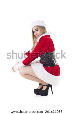 Portrait Of Pretty Young Woman In Santa Costume Smiling Over White Background - stock photo