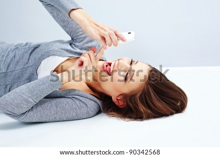 Portrait of pretty young  woman texting on cellphone - stock photo