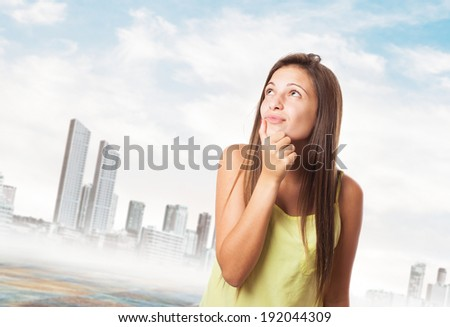 portrait of pretty young woman thinking about something - stock photo