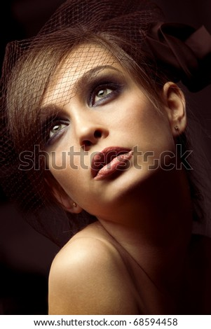 Portrait of pretty young woman. Vintage Make-up - stock photo