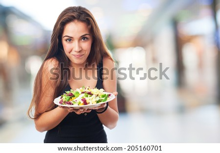 portrait of pretty young woman with a salad - stock photo