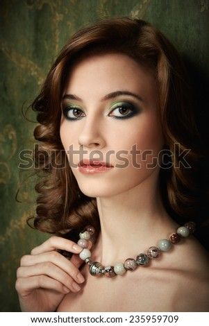 Portrait of pretty young woman with beads - stock photo