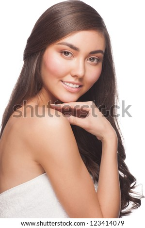 Portrait of pretty young woman with beautiful healthy skin and long bown hair. Isolated on white background - stock photo