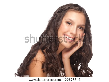 Portrait of pretty young woman with beautiful healthy skin and long brown hair. Isolated on white background