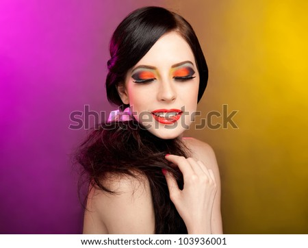 Portrait of pretty young  woman with bright colorful makeup - stock photo