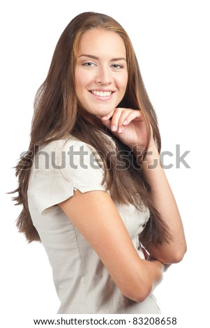Portrait of pretty young woman with crossed arms, against white background