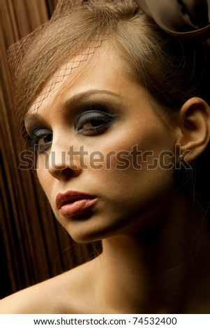 Portrait of pretty young woman with intent look. Vintage Make-up - stock photo