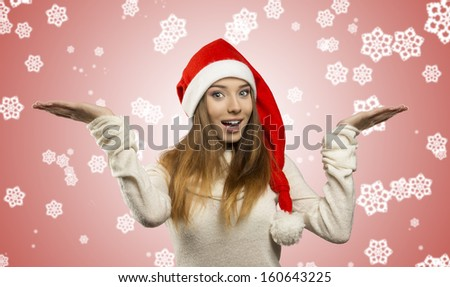 portrait of pretty young woman with long smooth hair and warm sweater posing with red Christmas hat and happy expression