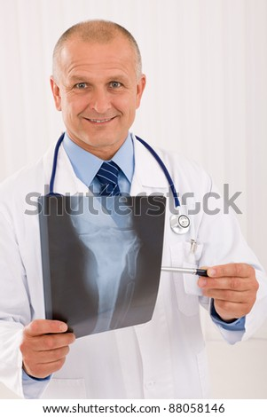 Portrait of professional male doctor hold and point x-ray