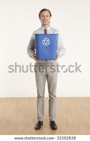 portrait of professional man holding a recycling bin - stock photo