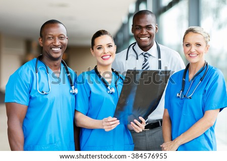 portrait of professional medical workers in hospital - stock photo