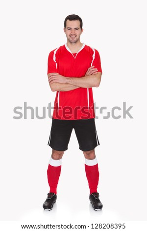 Portrait of professional soccer player. Isolated on white - stock photo
