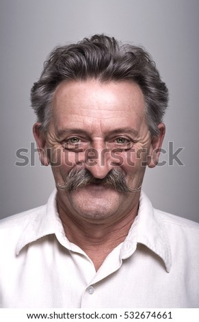 Portrait of proud senior man with mustache.