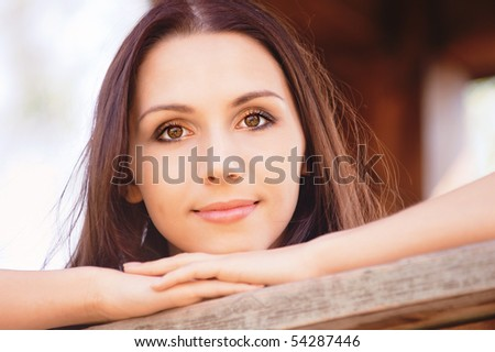 Portrait of quiet girl, leaning against handrail. - stock photo