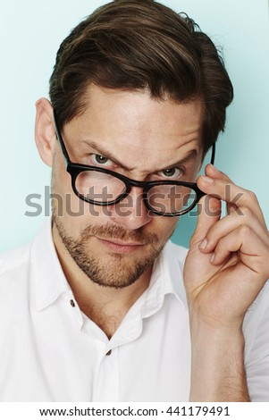 Portrait of quizzical man in eyeglasses