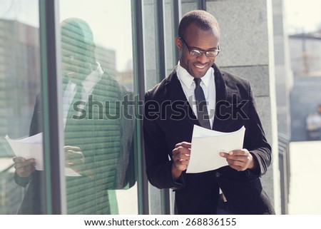 portrait of realtor with papers - stock photo