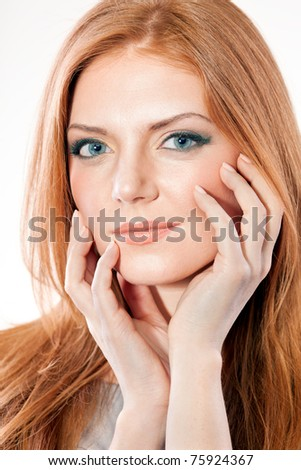 Portrait of red hair woman in studio