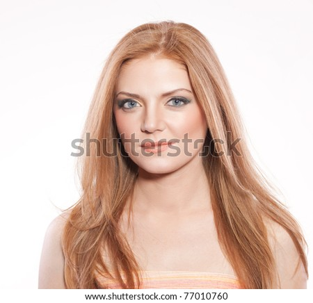 Portrait of red hair woman in studio on white