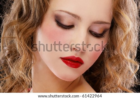 portrait of red-haired girl posing on black - stock photo