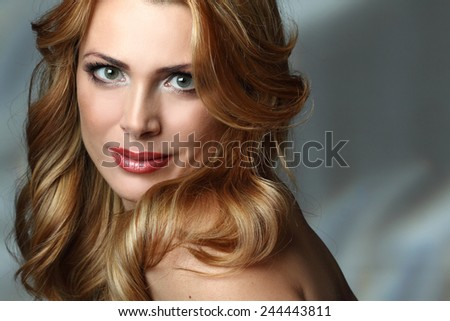 Portrait of red-haired girl with long braids. beautiful makeup. sexy lips. sensual look - stock photo