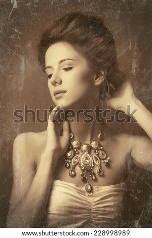 Portrait of redhead edvardian women with necklace. Photo in old image style. - stock photo