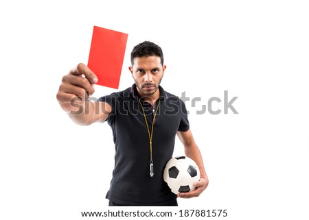 Portrait of referee holding ball and red card - stock photo