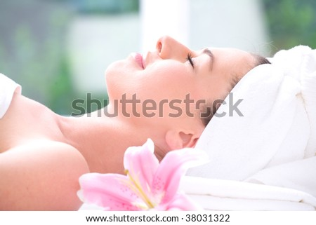 Portrait of relaxed and beautiful girl in spa concept - stock photo