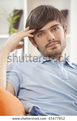 portrait of relaxed man resting on the sofa