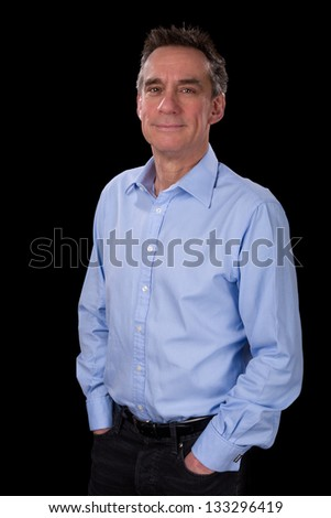 Portrait of Relaxed Smiling Middle Age Business Man in Blue Shirt Black Background - stock photo